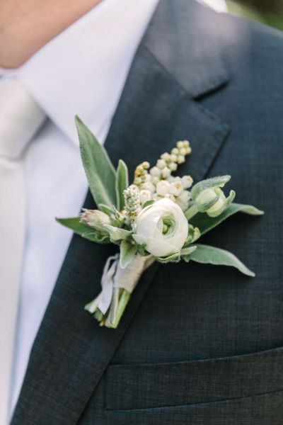 Ranunculus boutonniere: http://www.stylemepretty.com/california-weddings/sebastopol/2015/07/27/romantic-peach-white-spring-wedding/ | Photography: The Edges - http://theedgeswed.com/