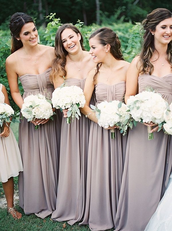 Dusty purple bridesmaid dresses...obviously wouldn't want them all to match, but I'm liking this color more and more for you/sisters!