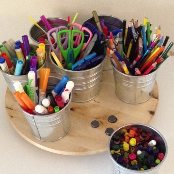 Magnetic Ikea art caddy.  Uses 6 of the 10.5 cm Socker buckets, one 13cm Socker bucket and then basic magnets from Home Depot.  Magnets are hot-glued onto the lazy susan (also from Ikea.)