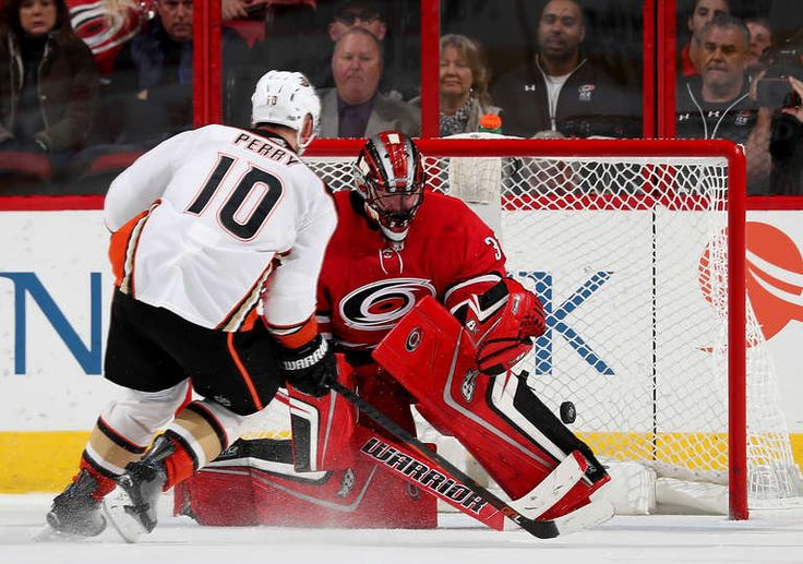 Corey Perry #10 of the Anaheim Ducks scores the winning goal on Scott Darling #30 in a shootout during an NHL game on October 29, 2017