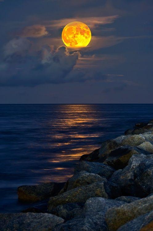 Golden moonlight over peaceful ocean