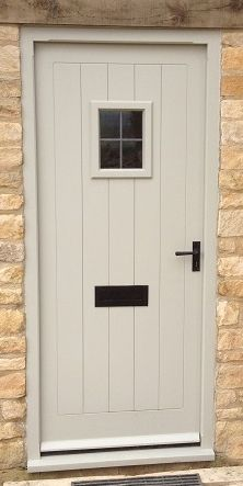 Stone coloured front door.