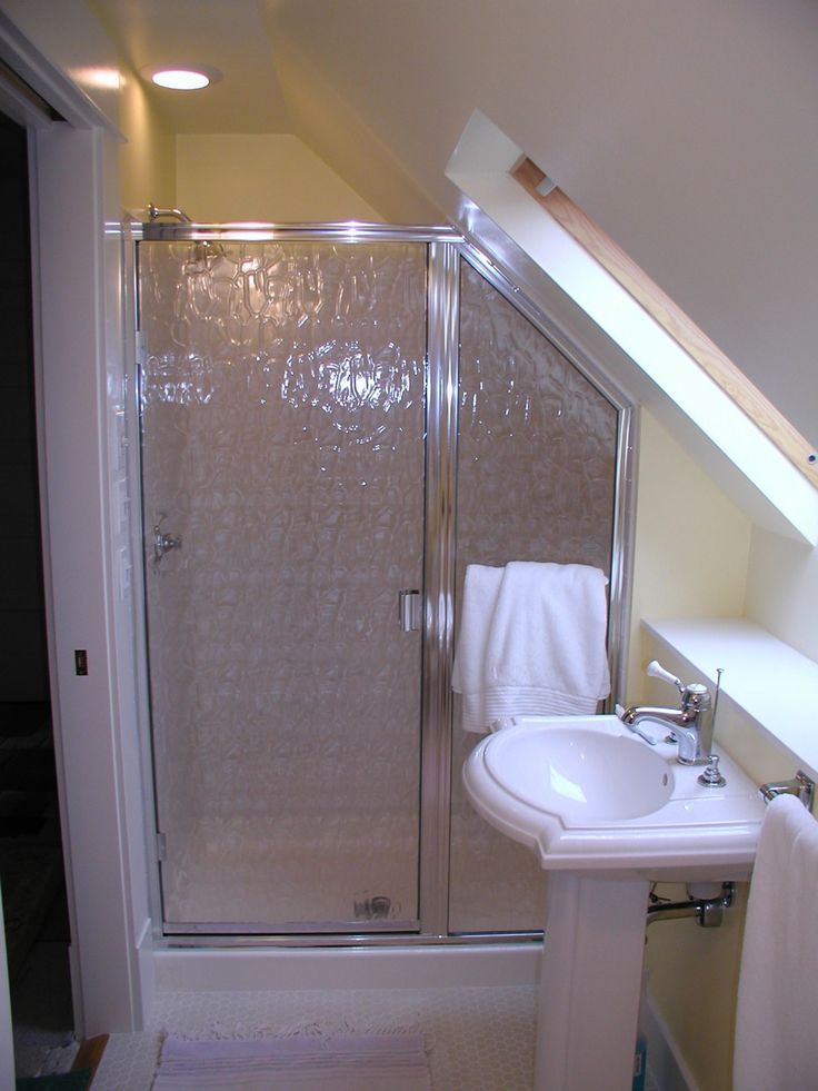 Small bathroom slanted ceiling shower raised shower tray for Small restroom