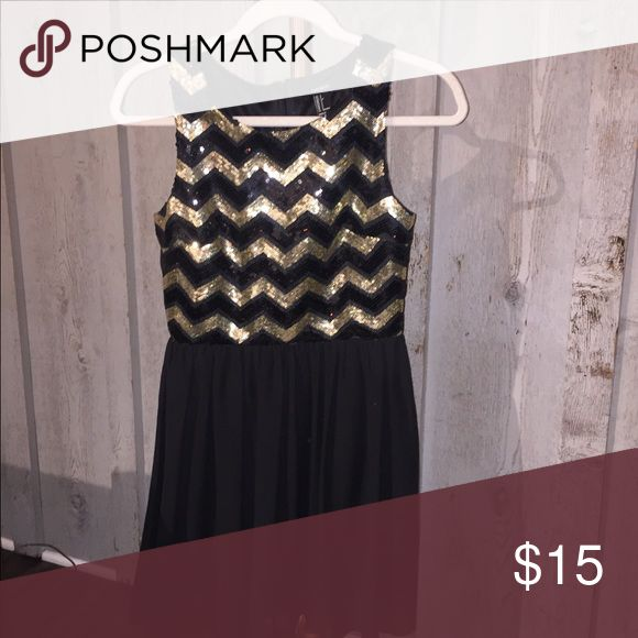 Sparkly Cocktail Dress Zig zag pattern, gold and black sparkly dress. Zippers up the back with a chiffon bottom. Forever 21 Dresses Mini