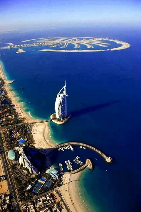 Dubai with the 6-star hotel, Burj Al Arab. Further ahead is the man-made Palm Resort, which looks like a palm tree when viewed from the top.