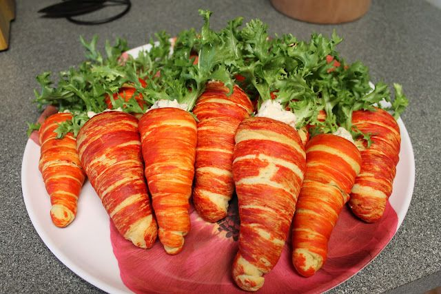 Crescent Roll Carrots for Easter. ok so at first I was not too sure about it but this is actually a cute idea & great for parties or just a fun family meal...