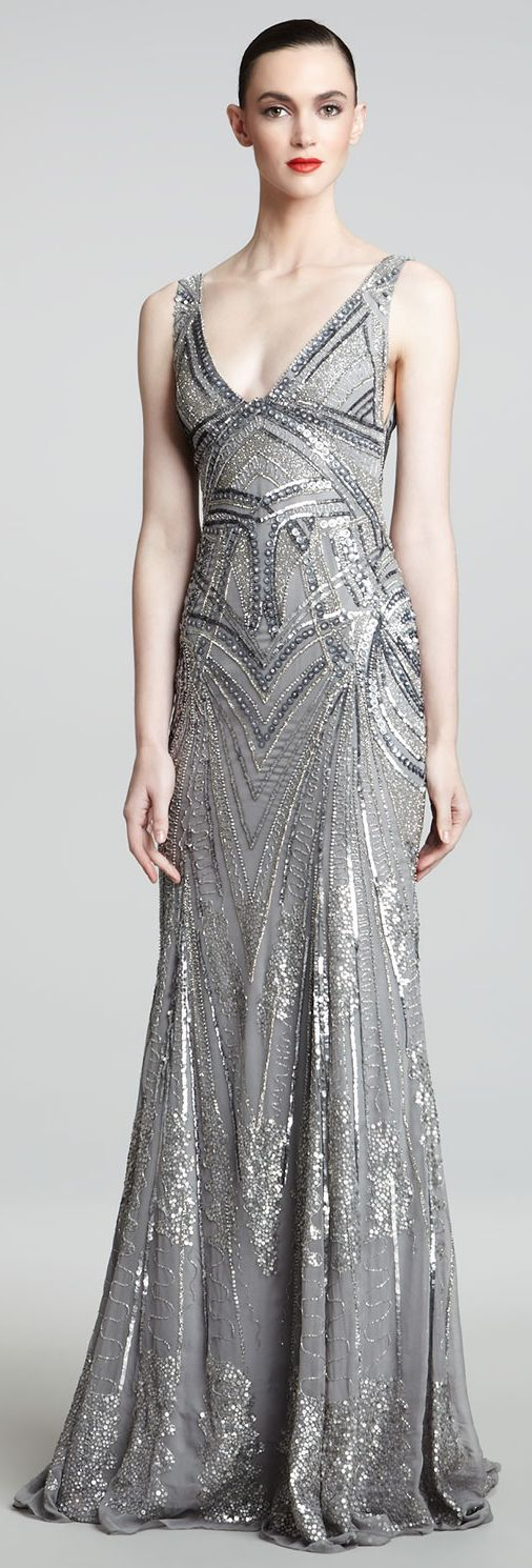 Monique Lhuillier  Art Deco Crystal and paillette embroidered, bias-cut evening gown.  Sleeveless; deep 'V' neckline; under bust seam.  Gown skims the waist & flows softly outward into lovely draped hemline