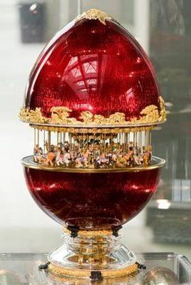 """Faberge Egg. That's a merry-go-round that is hiding inside this Imperial Egg. And yes, it is a working merry-go-round -- ingenious! Clicking on this site will enable you to see many of the 'Imperial Eggs' & their hidden treasures...Enjoy!"""