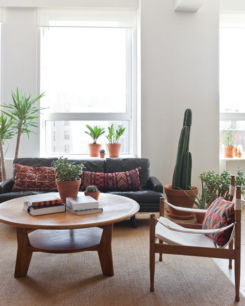 Refinery29 office area for informal meetings. And now I'm on the hunt for Danish safari chairs .. also, omg, the pillows!
