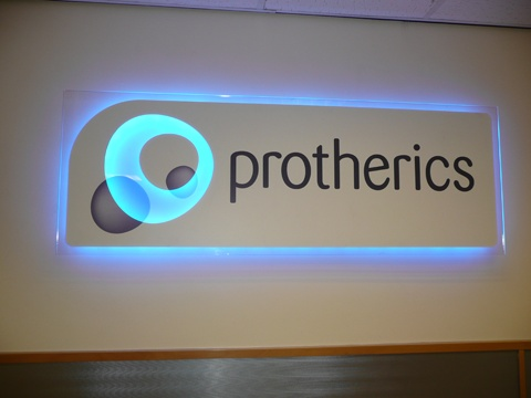 Edge & Back Lighted LED Signage: clear acrylic panel with dense vinyl decoration to hide the blue LEDs giving the back lighting