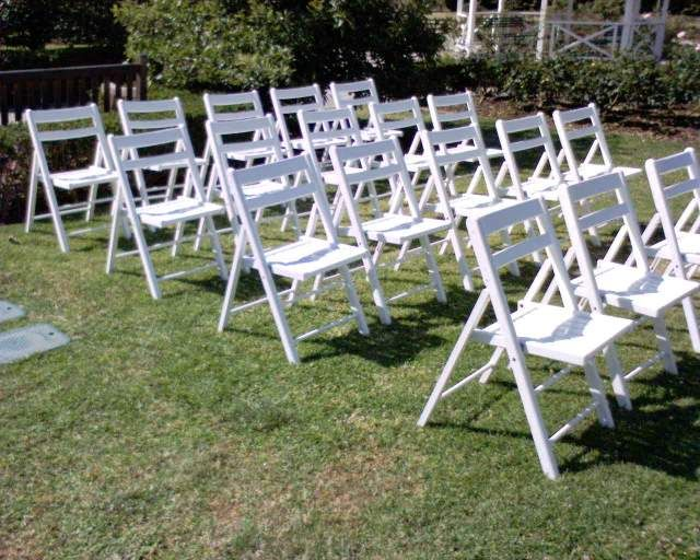 Comfortable elegance - rent white wooden painted chairs for your garden or beach wedding ceremony and reception