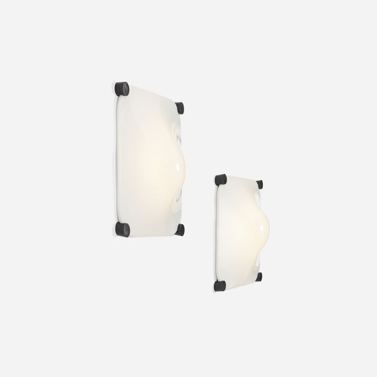 Lot 331: Elio Martinelli. Bolla Luminous wall panels, pair. 1965, acrylic, aluminum, plastic. 34 w x 10 d x 34 h in. estimate: $1,000–1,500. Signed with applied manufacturer's label to inside of each example: [Martinelli Luce].