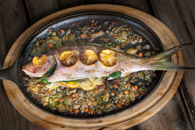 Oven-baked and stuffed with flavor, this fish is fall-off-the-bone delicious. (All photos credit: George Graham)