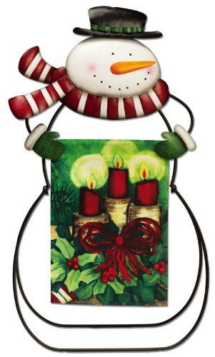 "Snowman Garden Stand Flag Holder by House-Impressions. $72.49. Perfect for holding any of our garden sized flags. 20""L x 9.75""W x 36""H. Metal. A fun outdoor accent. This snowman smiles underneath his long carrot nose, excited about the magic of the season. Below his scarf blowing back in the wind, he holds up a garden flag of your choice, adding to the holiday mood of your outdoor space. Your yard shouldn't be forgotten in the holiday decorations. It should be accented with..."