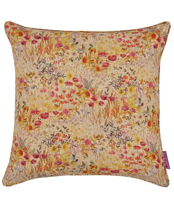 This Floral Clay Liberty Print cushion features a small scale covered floral design, representing the first growth in the garden.