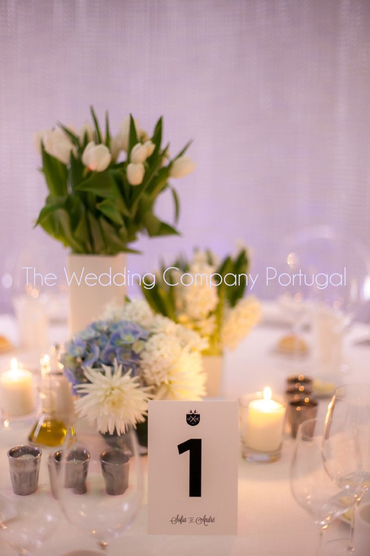 White tulips centrepieces by The Wedding Company - Portugal.  Photo by Catarina Zimbarra Photography.