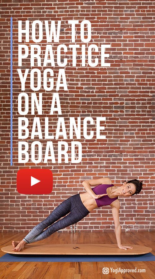 Practicing yoga on a balance board strengthens and tones your body and advances ...