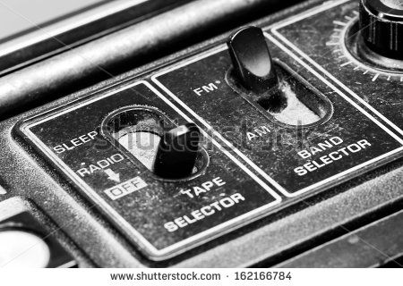 Retro switch on the top of cassette player. - stock photo