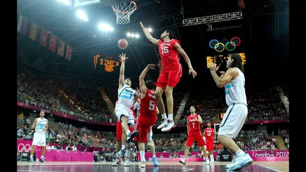 Leo Gutierrez #7 of Argentina shoots against Salah Mejri #15 of Tunisia in the first half during the Men's Basketball Preliminary Round match on Day 6 of the London 2012 Olympic Games at Basketball Arena on August 2, 2012 in London, England. (Photo by Christian Petersen/Getty Images)