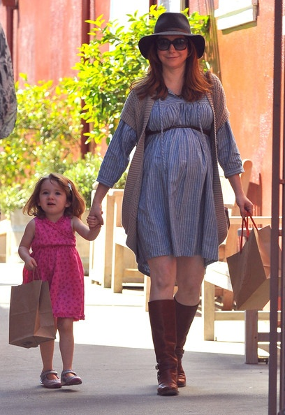 Happy Birthday to Alyson Hannigan!! The Pregnant Buffy the Vampire and How I Met Your Motheractress, seen here with her daughter Satyana Denisof out shopping at the Brentwood Country Mart in Brentwood, California on March 10, 2012, turns 38 today!