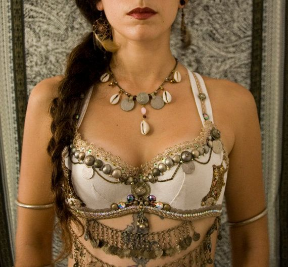 KHIONE: A Snow Nymphe of the region of Thrake, north of Greece. She was a daughter of Boreas, god of winter. She was loved by Poseidon, but cast