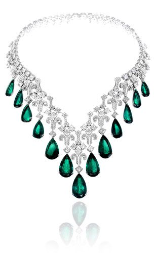 Chopard Columbian emerald necklace – centrepiece of their Haute Joaillerie collection.  73 square and 830 round brilliant-cut white diamonds with 13 cascading pear-drop emeralds.  For the May babies