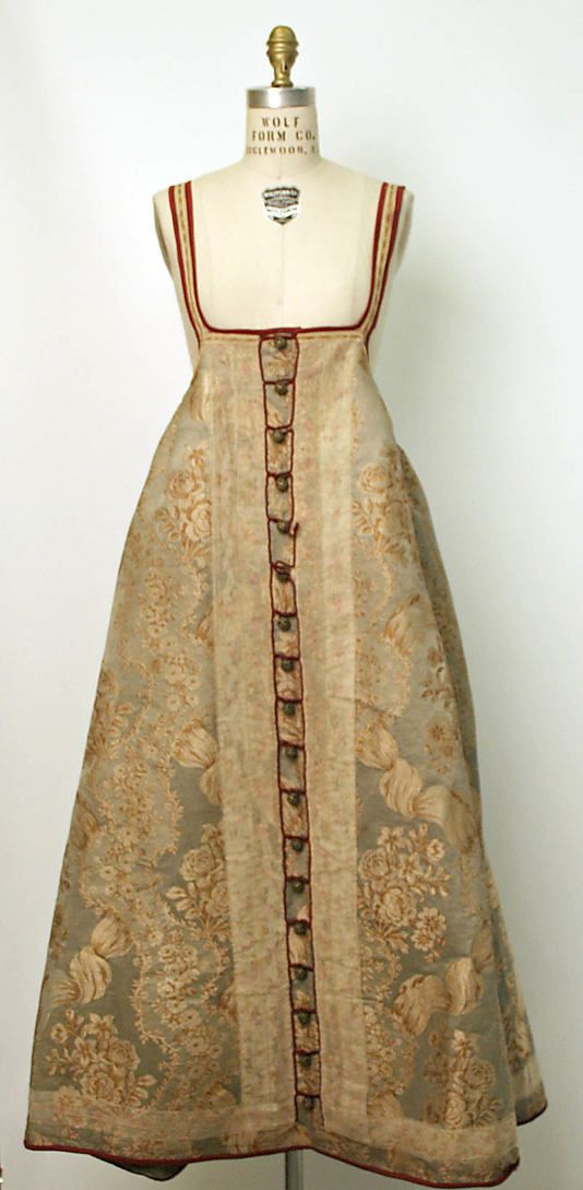 Russian sarafan. 19th century Culture: Russian Medium: silk, cotton or linen Dimensions: (a) Length at CB: 41 in. (104.1 cm) (b) Length at CB: 17 1/2 in. (44.5 cm)