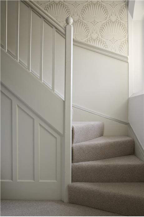 Painting panelling and spindles in one colour, breaking at dado rail and another colour above.