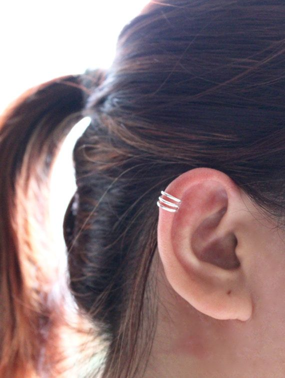 *** Low Flat Rate Air Mail shipping fees to all countries*** *Shipping Fees: $3.50 for the first item and $0.50 for each additional item* Sterling Silver Triple Band Ear Cuff, need no piercing. Get cuffed in the best way possible. This ear cuff sits right on your ear cartilage. Give it a gentle pinch to keep it snug against your ear. ★ 3 bands ★ 10mm diameter ★ Adjustable opening for getting cuff on and off, squeeze to tighten ★ Material: Sterling silver ++ This listing is for 1 cuff only…