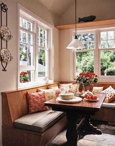 Kitchen inspiration (banquette with vintage flair creates bright nook). Angled backs and legs... I'd love to find a house with a window in the kitchen like this. I love how this looks.