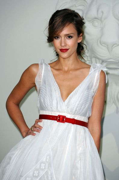 Jessica Alba Messy Updo - Jessica completed her stunning look with a messy, twisted updo and side-swept swing bangs.