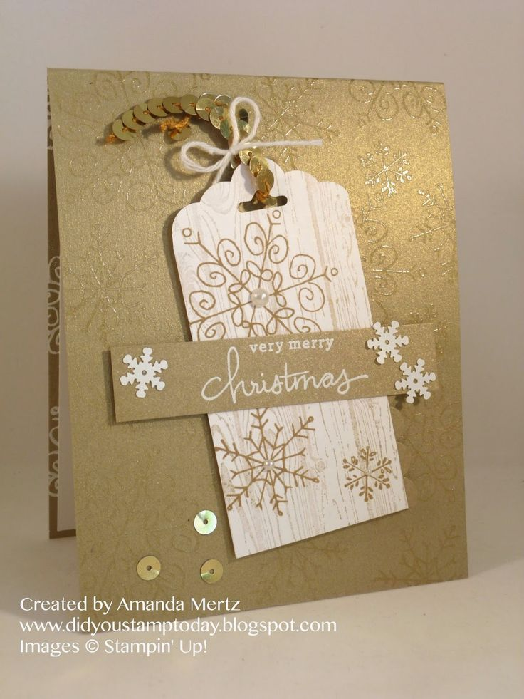 SU! Endless Wishes stamp set; base is Brushed Gold cardstock embossed with clear snowflakes; Whisper White tag punched with Scallop Tag Topper punch and stamped with Hardwood background stamp in gold ink and Endless Wishes snowflakes in Baked Brown sugar - Amanda Mertz