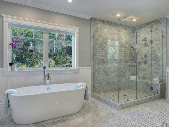 Contemporary Look The clean and minimalist look of modern design meets the revered classics with a standalone tub for two. The sense of space is enormous here, making even smaller bathrooms in this style look roomy and inviting.