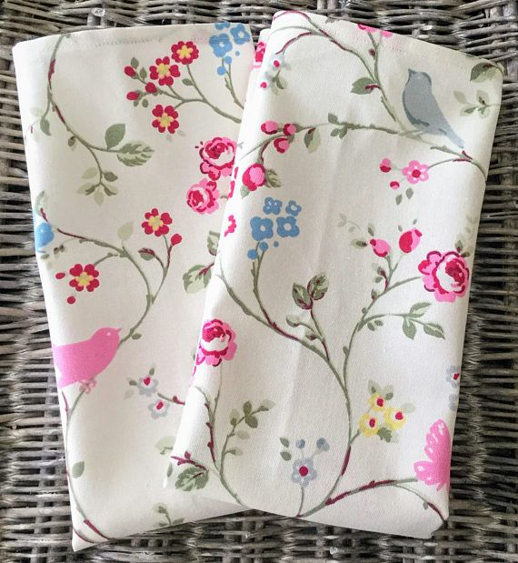 Floral and bird print cotton tea towel in off white fabric  with pink, blue and grey accents and butterflies