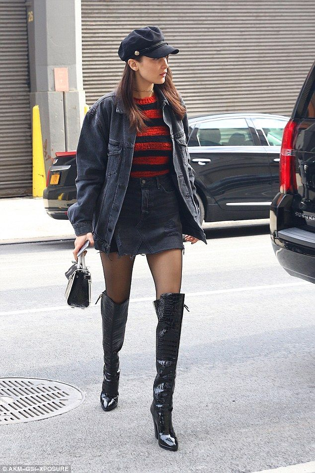 Looking fly: She added a black and red striped sweater and denim jacket over the top...