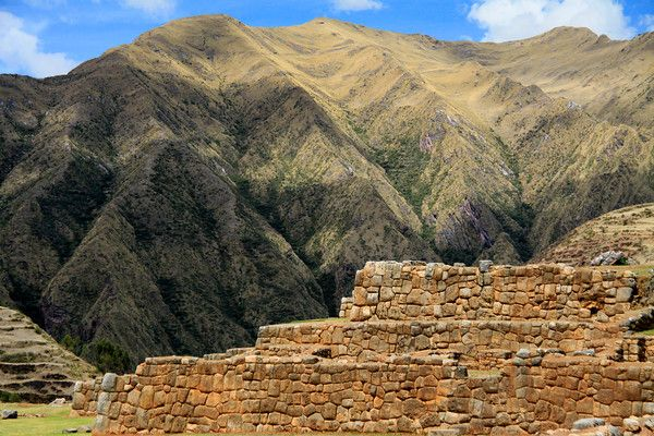 From the sunlit Chinchero Ruins - to the partially cloud-shaded Hatun Luychu Mountain, along the Cordillera Vilcanota - Cusco department.