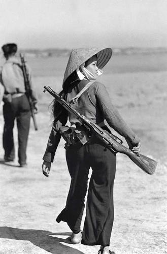 Vietnamese female soldier. Pretty but very dangerous.