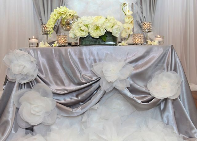 backdrop of oversized paper flowers, peonies, orchids and crystal settings; design by Davis Floral Creations