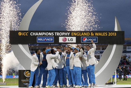 The Indian cricket team celebrate winning the 2013 ICC Champions Trophy final against England @ Edgbaston (Birmingham)  A couple of interesting things to note: - it seemed like India were the home team as there were more Indians than English in the crowd. - There was NO scheduled reserve day for the final - it would have been ludicrous if the game was rained off and the trophy shared!