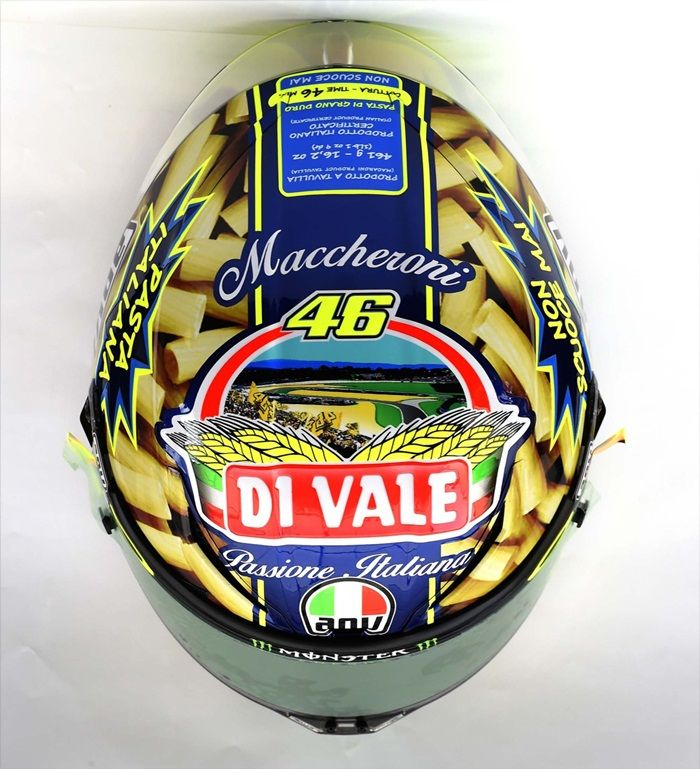 """Valentino Rossi 'Di Vale' Pasta Helmet (Mugello): Valentino Rossi had a uniquely Italian helmet design for his home race at Mugello in 2014. The helmet was made to look like a pasta box, complete with Rigatoni pasta, a brand label called 'Di Vale', and cooking instructions for 46 minutes.  The helmet also featured the phrase """"non scuoce mai"""", which means """"doesn't overcook"""" – a reference aimed at his critics. http://rossihelmets.com/valentino-rossi-di-vale-pasta-helmet-mugello-2014/"""