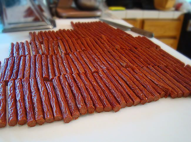 Beef Snack Sticks - I have used this recipe with great success -  (Not the link on the pic)  http://www.dakotahsausagestuffer.com/Articles.asp?ID=363  *  We  don't even grind the meat/fat any more, just buy lean hamburger, because it is the right ratio of meat-fat.  I'm serious!  Let me know if you try the Dakota recipe - we double the spices, too, and just use sugar instead of the corn syrup solids.  We also add a bunch of mustard seed.  We have an electric smoker.