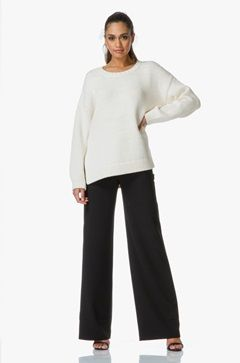 T by Alexander Wang brings a contemporary black pair of trousers with wide legs for a relaxed feel.