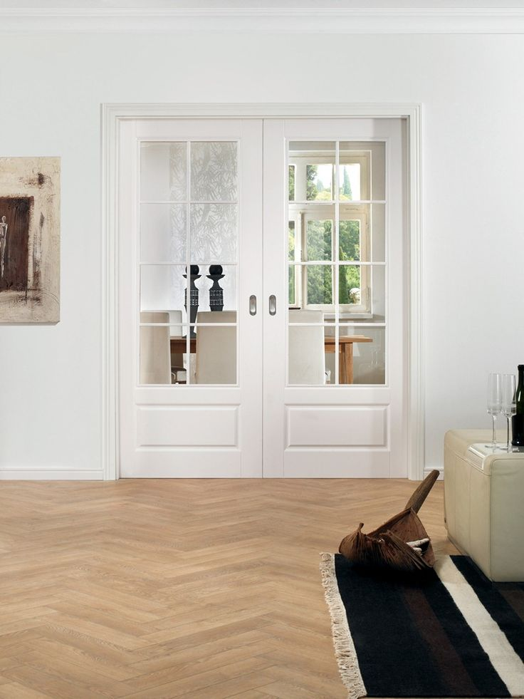 Double Doors – Pocket System White Finish RAL 9010 Pocket Double Doors Sliding System  –  Invisible sliding technique New perspectives by running into the wall sliding systems. These doors will fit in almost any room and are also easy to install later. One advantage: you will get the full floor space in the living room, because rails and doors in the wall disappear without a trace.