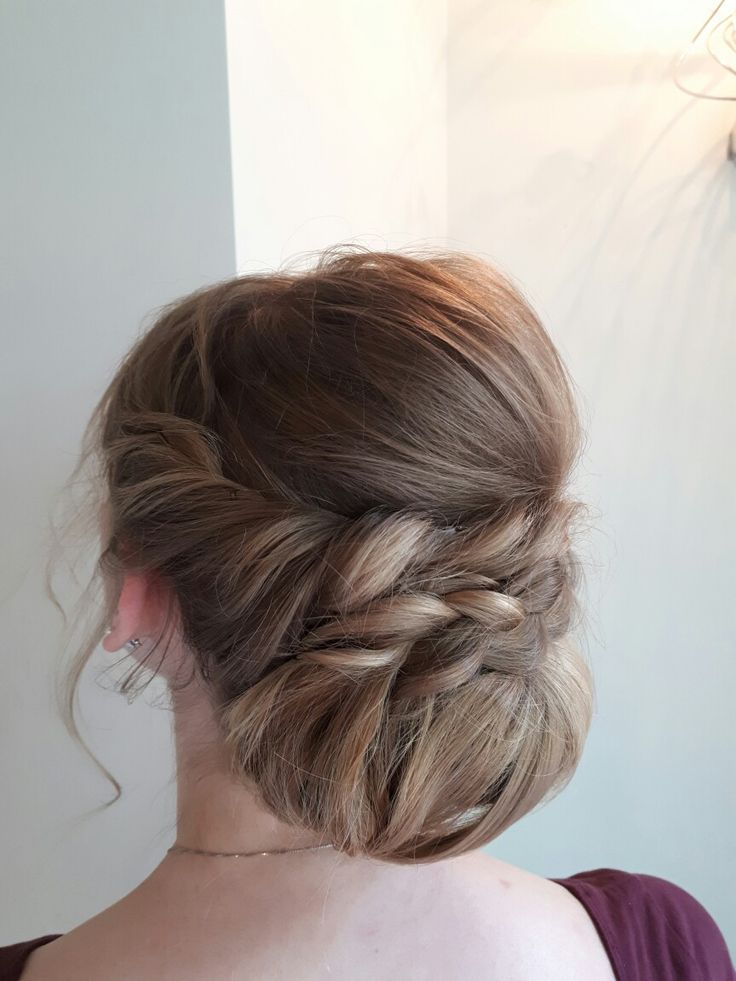 A formal sophisticated  updo for a graduation, prom or a wedding