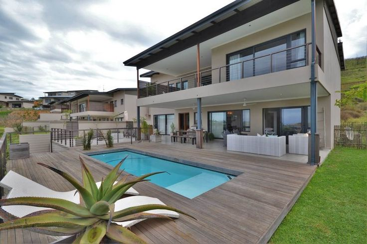 Stunning luxury four bedroom all en suite house in the upmarket Simbithi Eco Estate. This beautiful home boasts open plan living with really modern finishes. The house has a lovely private pool with great views over Simbithi and of the ocean.  #HomesInKwaZuluNatal #PropertyForSale #KwaZuluNatal #Ballito #Durban #ResidentialEstates