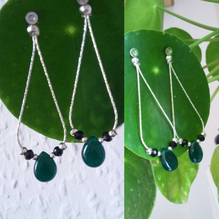 #Silver wire drop long #earrings with deep green jade stones and black crystals.