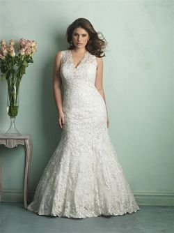 Allure Style: W340 This is a lace v-neck gown with a vintage appeal. We have her in ivory/cafe in a size 18W. Sizes go up to a 32W.