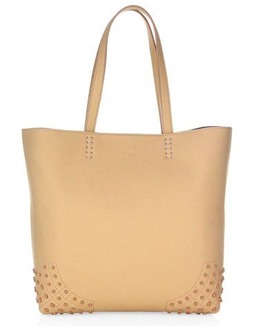 """gommini wave leather tote bag by Tod's. Timeless tote crafted from deluxe leather. Double top handles, 8.2"""" drop. Snap button closure. Goldtone hardware. One interior open pocket. Leather lining. Includes dust bag and authenticity card.12.5""""W x 12.2""""H x 5.5""""D.Leather. Made in ... #tods #bags"""