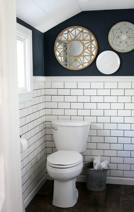 Project by: Christina Location: Quakertown, Pennsylvania This bathroom was as bad as it gets - a rotten floor, pink laminate walls, and GROSS all over. Walking into this room now, you would never imagine how terrible it looked before! Crisp white subway tiles, dramatic navy walls, and touches of gold make this room a knock-out!