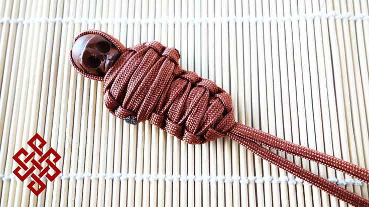 "King Mummy Paracord Lanyard Tutorial I realized I never did a dedicated tutorial for this lanyard, so here it is. The King Mummy paracord lanyard. The beads are called ""Nyahtoh Wood"" skull beads. You can find them on etsy or ebay. Let me know what you Weavers think!"